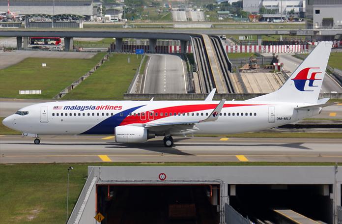 Comoé voar com a Malaysia Airlines: Boeing 737-800 no KLIA